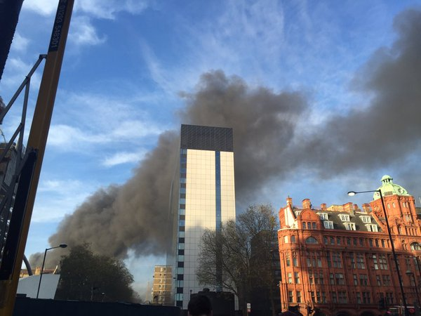 Smoke dominates sky-line during rush hour commute in City of London. Image:@LondonFire