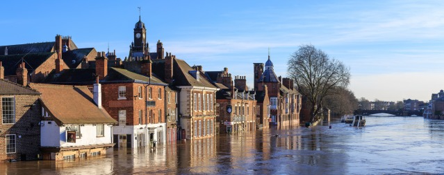 The river Ouse rises high, damaging homes and businesses along the river front. Image credit: Allen Harris on Flickr. Creative Commons license.