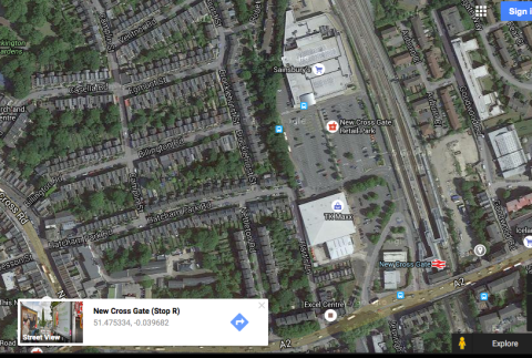 Google satellite map showing entrance to illegal dump site