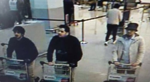 Belgian police release CCTV image of airport bombing suspects. Two men on left believed to be suicide bombers. Man in hat on right believed to be at large. Image: Brussels Police