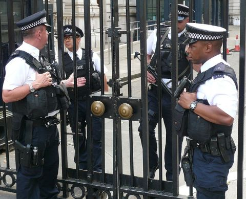 Armed police officers. Downing Street gates, 2014 Image: Stanislav Kozlovskiy Wikipedia Creative Commons