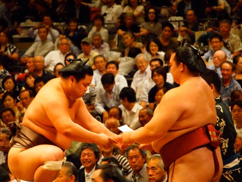 Kisenosato (right) takes on an opponent in the ring. Source: Yavodkalove, Wikimedia Commons